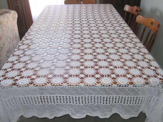Large oval Tablecloth - Finished size: 54 x 88 inches.. Use